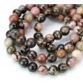 Black Veined Rhodonite Beads, 8mm Round, 15 Inch Strand