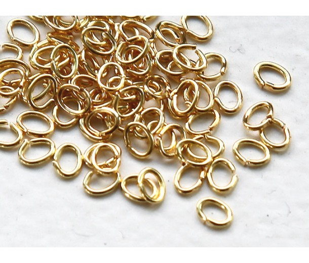 3x4mm 22 Gauge Open Jump Rings, Oval, Gold Tone, Pack of 100