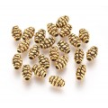7mm Oval Bali Style Beads, Antique Gold, Pack of 20