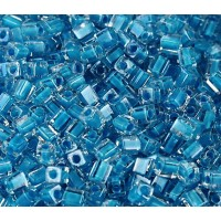 4mm Miyuki Square Beads, Turquoise Lined Crystal, 10 Gram Bag
